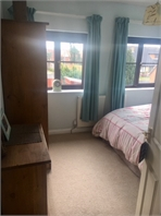 Light queen sized room in large house in village location with good transport links